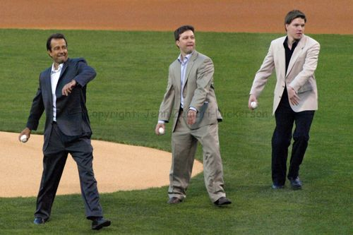 Harry's sons throw first pitch
