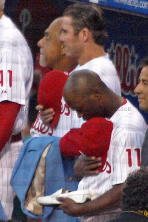 Jimmy Rollins & Chase Utley; holding Harry's shoes & jacket